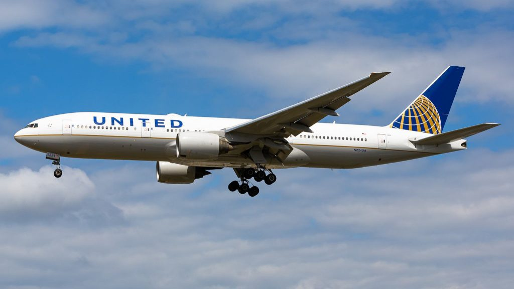 United States.  The passenger wanted to enter the cockpit.  The plane made an emergency landing